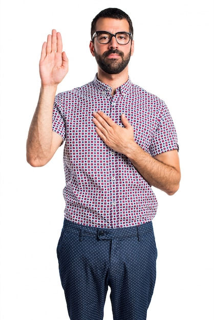Man with glasses doing an oath Free Photo