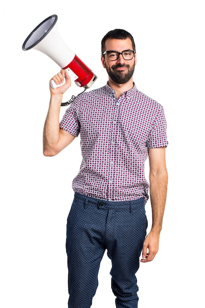Man with glasses shouting by megaphone Free Photo