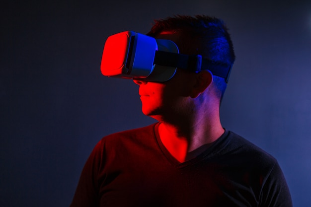 The man with glasses of virtual reality on black isolated background. Free Photo