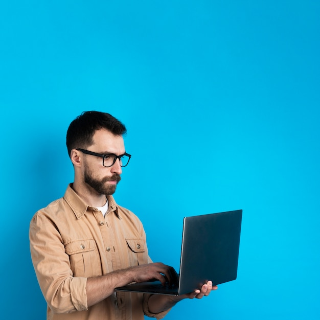 Man with glasses working on laptop Free Photo