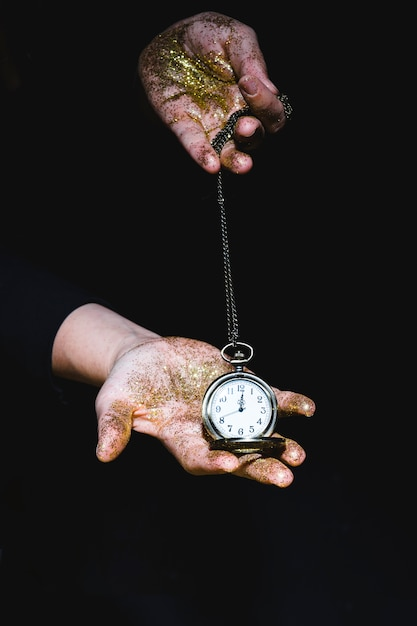 Man with glitters showing pocket watch Free Photo