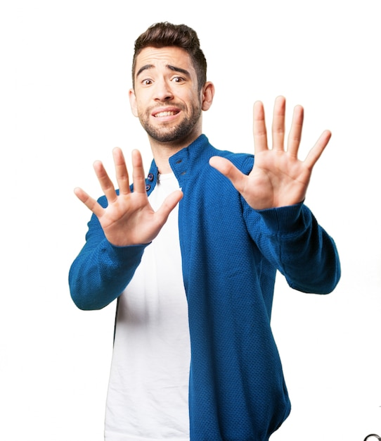 Man with hands in front of body Free Photo