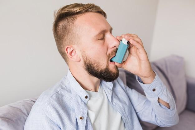 Man with inhaler Free Photo