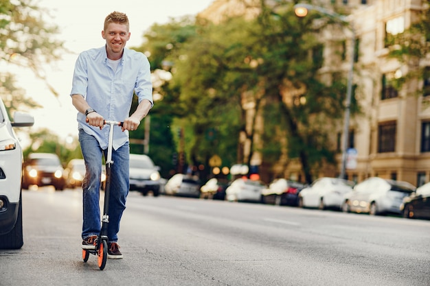 Man with kick scooter Free Photo