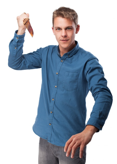 Man with a knife in his hand Free Photo