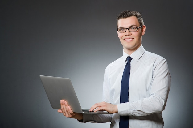 Man with laptop in business concept Premium Photo