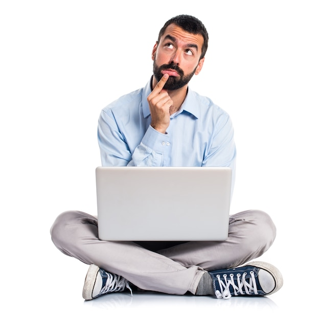 Man with laptop thinking Free Photo