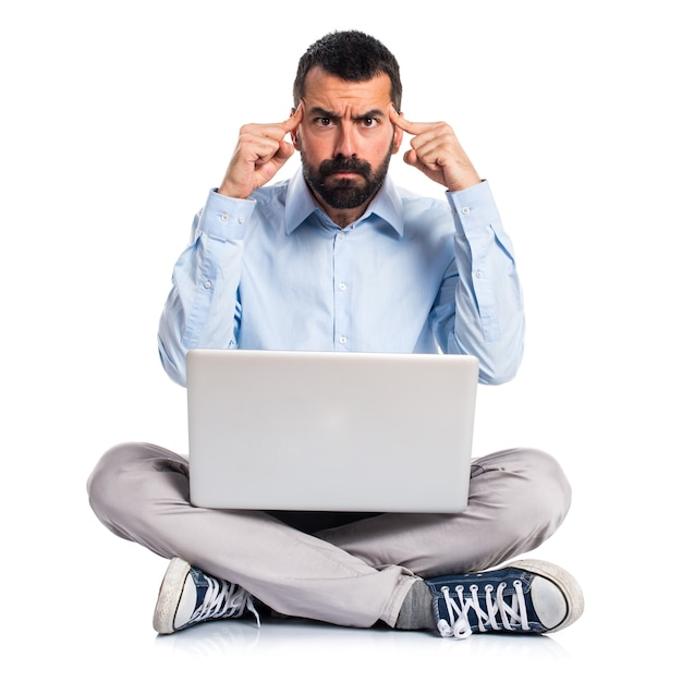 Man with laptop thinking Free Photo