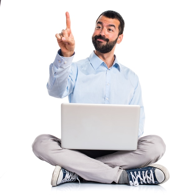 Man with laptop touching on transparent screen Free Photo