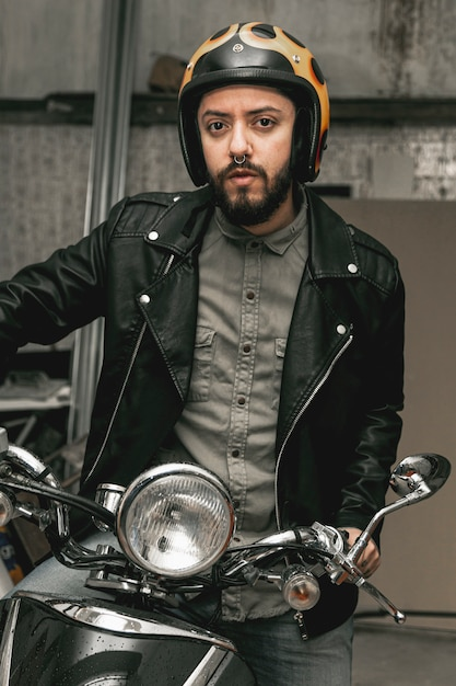 Man with leather jacket on motorcycle Free Photo