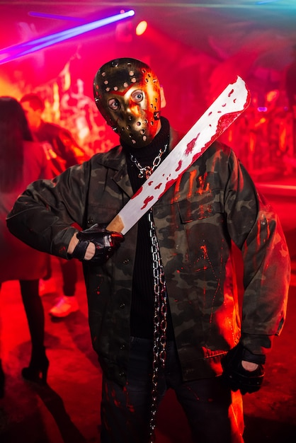 Man with mask on halloween in a bloody suit Premium Photo