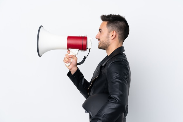 Man with a motorcycle helmet shouting through a megaphone Premium Photo