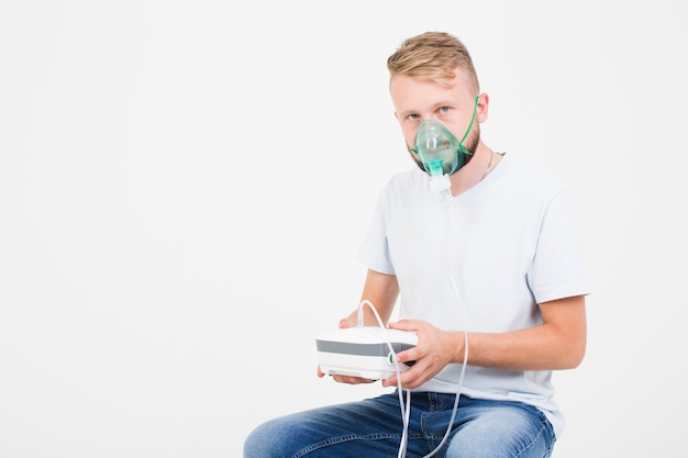 Man with nebulizer for asthma Free Photo