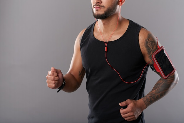 Man with phone in armband running Free Photo