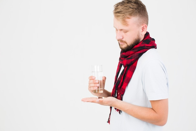 Man with pill in hand Free Photo