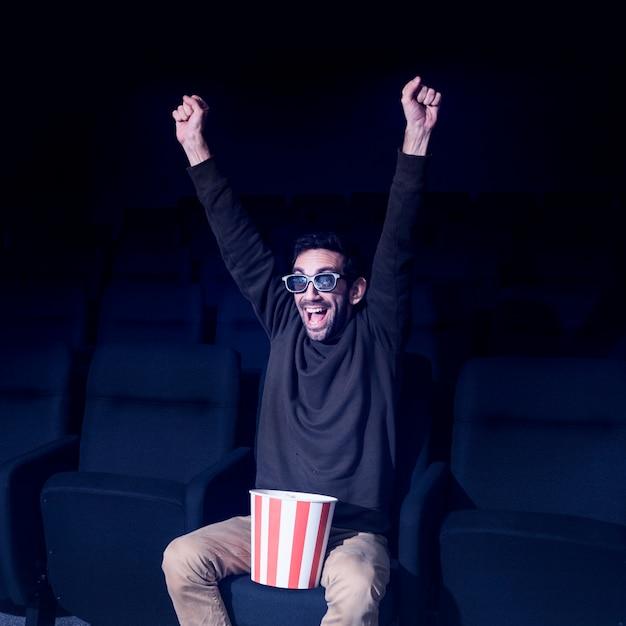 Man with popcorn in cinema Free Photo