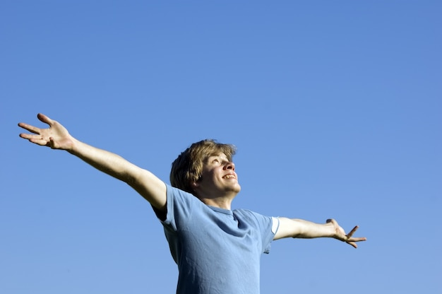 Man with raised arms Free Photo