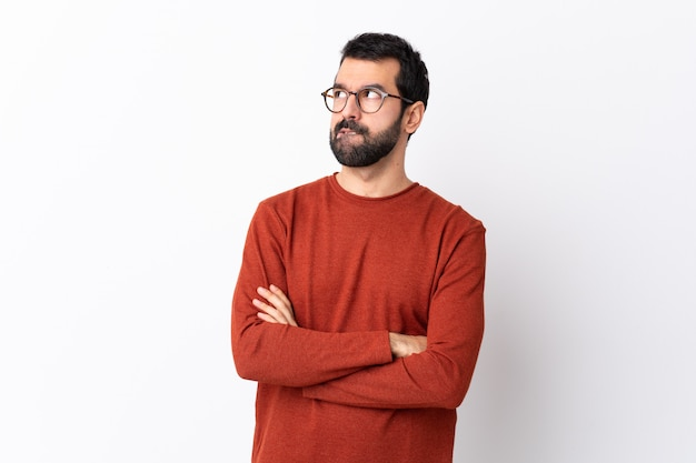 Man with red sweater posing Premium Photo