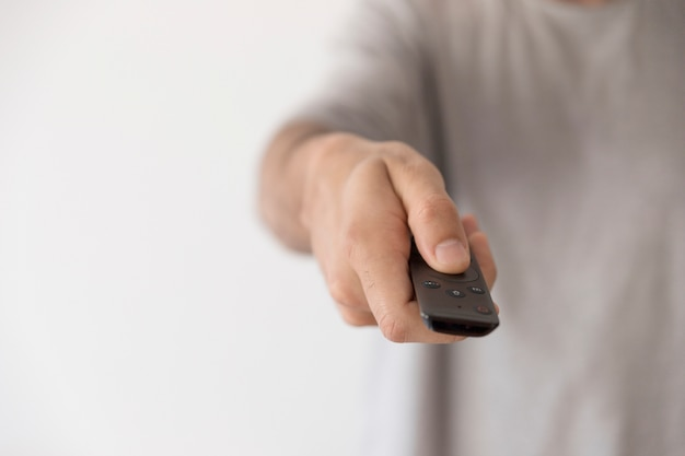 Man with remote control Free Photo