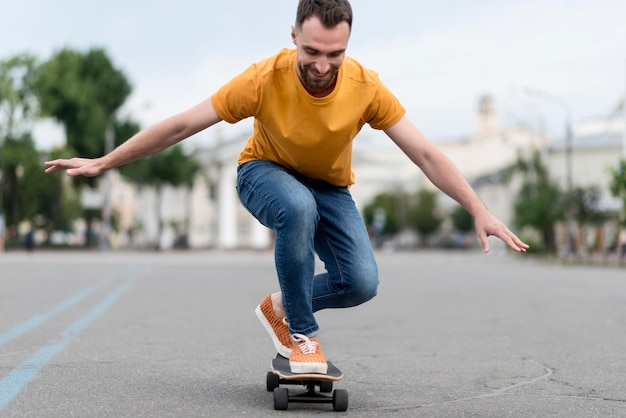 Man with skateboard front view Free Photo