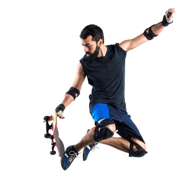 Man with skateboard jumping Free Photo