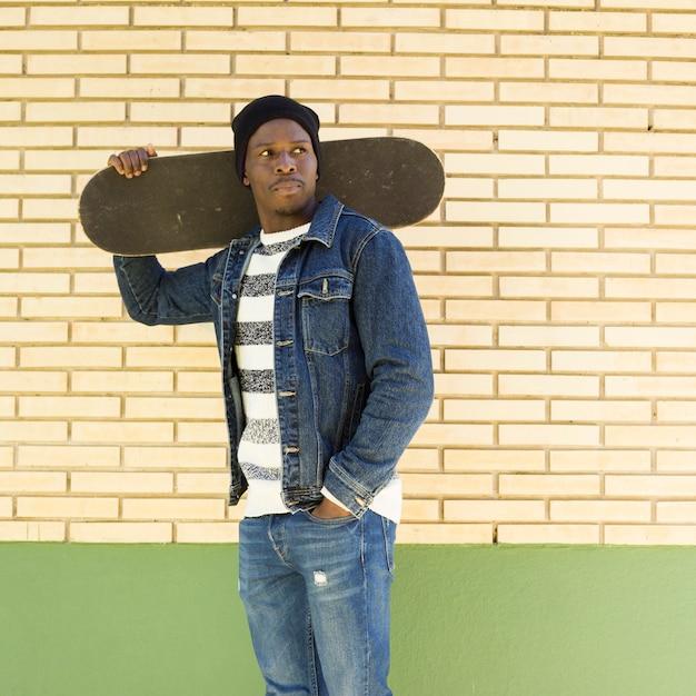 Man with skateboard Free Photo