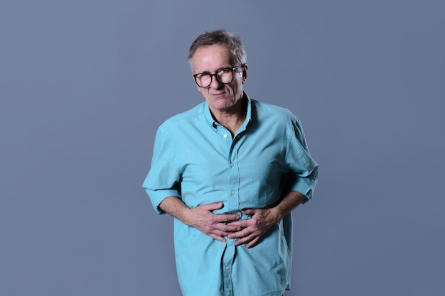 Man with stomach ache Free Photo