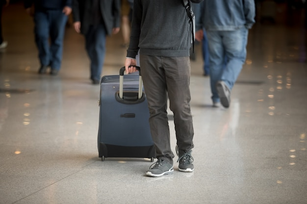 Man with a suitcase Free Photo
