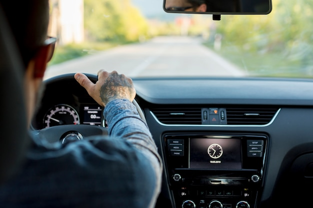 Man with sunglasses driving automobile Free Photo