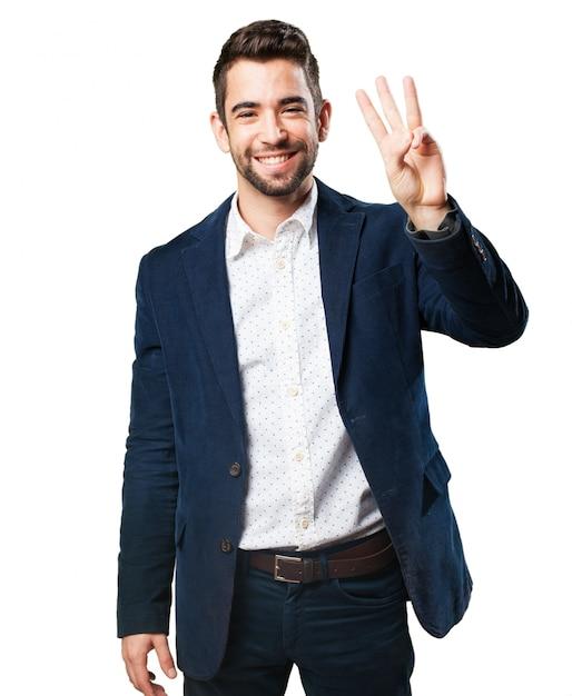 Man with three fingers raised Free Photo