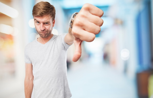Man with thumb down Free Photo