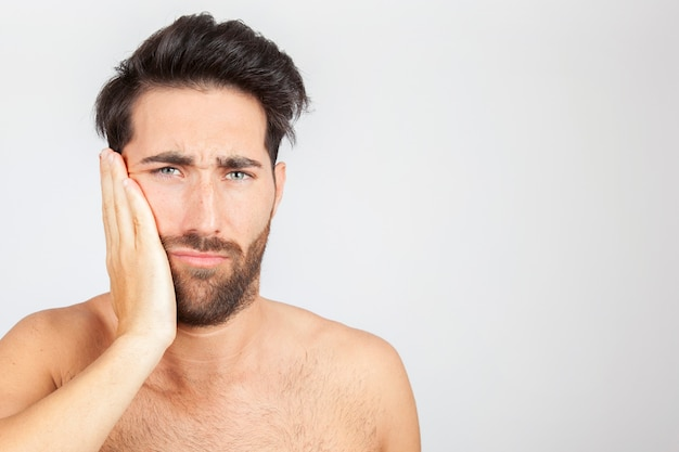 Man with toothache Premium Photo