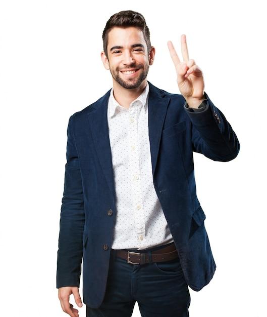 Man With Two Fingers Raised Photo