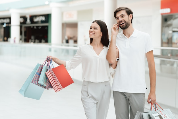 Man and woman are walking to another store in shopping mall. Premium Photo