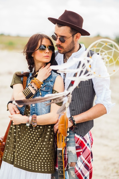 Man and woman as boho hipsters against blue sky Free Photo