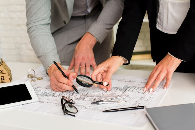 Man and woman checking a construction plan Free Photo