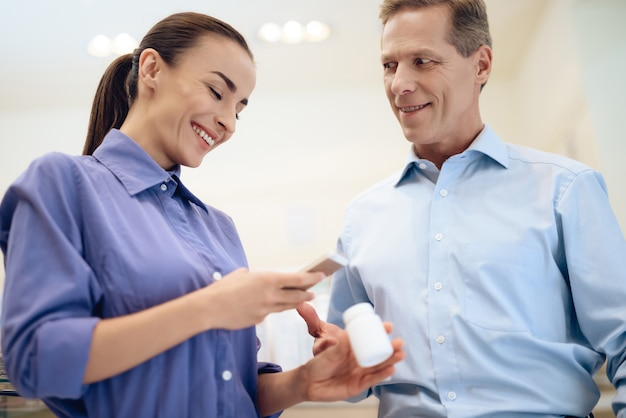 Man and woman choosing medicines in pharmacies. Premium Photo