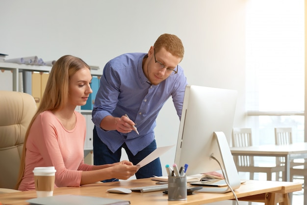 Man and woman coworking on business document generating ideas Free Photo