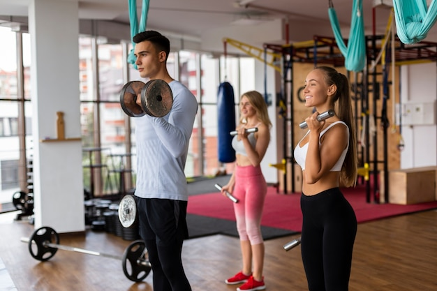 Man and woman doing weight training Free Photo