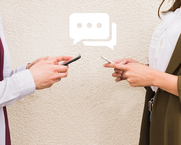Man and woman exchanging messages on mobile phone Free Photo