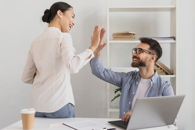 Man and woman giving high five Premium Photo