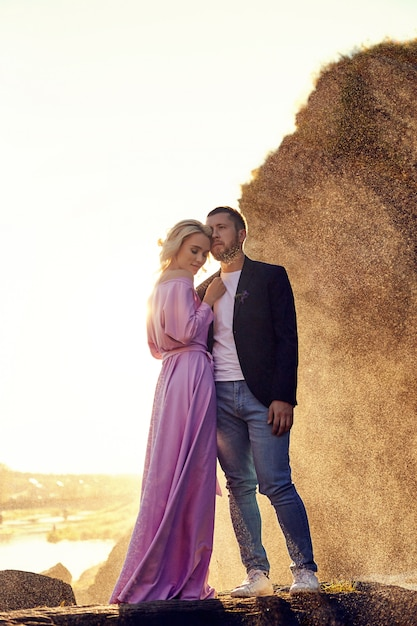 Man and a woman hugging in the summer Premium Photo