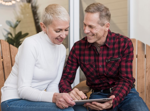 Man and woman looking on their tablet Free Photo