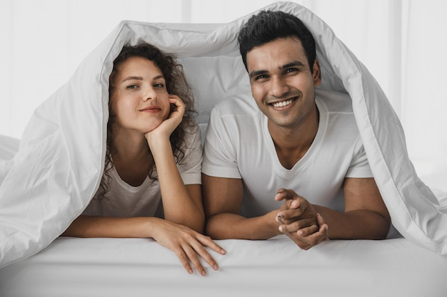 A man and a woman lying on a bed Premium Photo