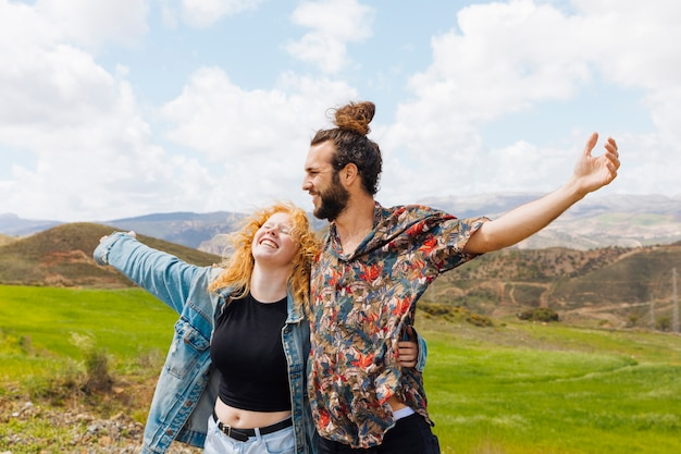 Man and woman open arms in nature Free Photo