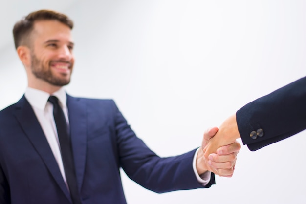 Man and woman shaking hands Free Photo