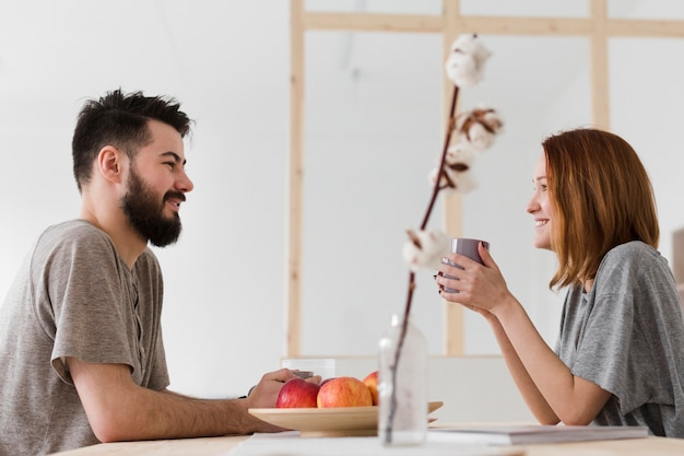 Free Photo | Man and woman talking in the kitchen
