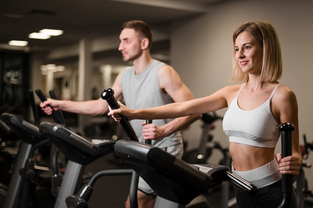 Man and woman training together Free Photo