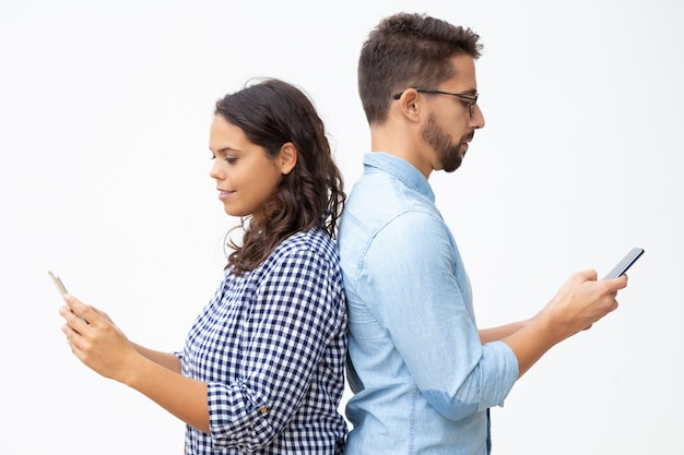 Man and woman using smartphones Free Photo