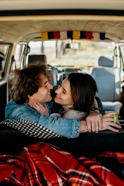 Man and woman wanting to kiss in a van Free Photo